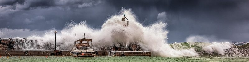 Waves crashing against a lighthouse.